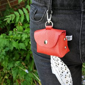 red-poopurse